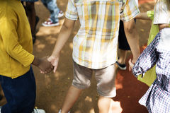 Diverse kids holding hands together Royalty Free Stock Photo