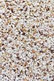 Diverse kiezelsteenstenen en de rots van de Perzik Stock Fotografie