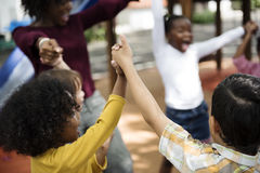 Diverse kindergarten students hands up together. Group of diverse kindergarten students hands up together Royalty Free Stock Photo