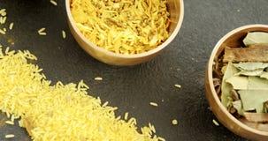 Diverse kruiden in kom met gele rijst 4k stock video