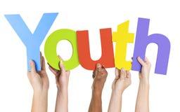Diverse mani che tengono la gioventù di parola Fotografie Stock Libere da Diritti