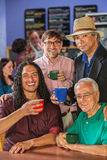 Diverse Men in Coffee House Stock Photography