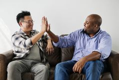 Diverse men joining hands together Stock Image