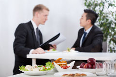 Diverse men during lunch time. Diverse men during business lunch time, horizontal Royalty Free Stock Photography