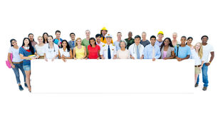 Diverse Multi ethnic People Standing Holding Placard Royalty Free Stock Photography