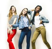 Diverse multi nation girls group, teenage friends company cheerful having fun, happy smiling, cute posing isolated on. White background, lifestyle people royalty free stock photo