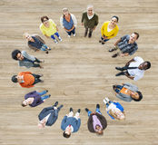 Diverse Multiethnic Colorful People Forming a Circle Stock Photos