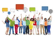 Diverse Multiethnic People Celebrating with Their Hands Raised.  Royalty Free Stock Image