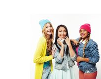 Diverse nation girls group, teenage friends company cheerful hav. Ing fun, happy smiling, cute posing isolated on white background, lifestyle people concept royalty free stock photography