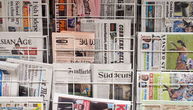 Diverse Newspapers. London Newspaper stand refects the diverse range of newspapers and languages of modern London Royalty Free Stock Photography