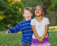 Diverse pair of children playing together Royalty Free Stock Image