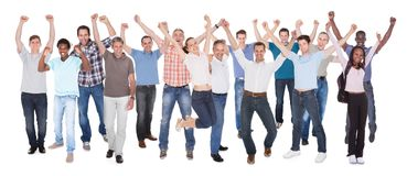 Diverse people in casuals celebrating success. Full length portrait of diverse people in casuals celebrating success against white background Royalty Free Stock Photos
