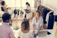 Diverse people checking out clothes stock photo