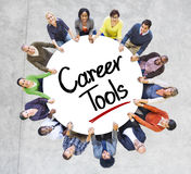 Diverse People in a Circle with Career Tools Concept Royalty Free Stock Photography