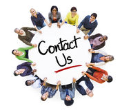 Diverse People in a Circle with Contact Us Concept Royalty Free Stock Image