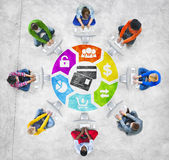 Diverse People in a Circle Using Computer with Financial Concept Royalty Free Stock Image