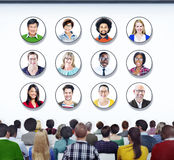 Diverse People in a Conference About Ethnicities Royalty Free Stock Images