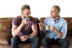 Diverse people having coffee together stock images