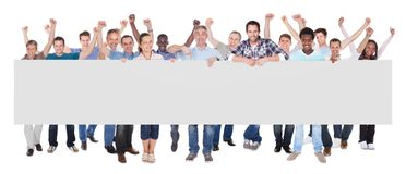 Diverse people holding blank placard Stock Image