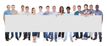 Diverse people holding blank placard Stock Photos