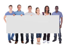 Diverse People Holding Blank Placard Stock Photo