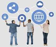 Diverse people holding blue networking icons stock photos