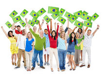 Diverse People Holding Brazilian Flag Royalty Free Stock Photo