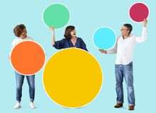 Diverse people holding colorful blank circles Royalty Free Stock Image