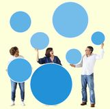 Diverse people holding colorful blank circles Stock Photography