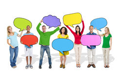 Diverse People Holding Colorful Speech Bubbles Stock Image