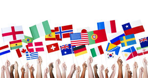 Diverse People Holding Diverse National Flags.  Royalty Free Stock Images