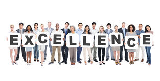 Diverse People Holding Excellence. Multi-Ethnic Group Of Diverse People Holding Letters That Form Excellence stock image