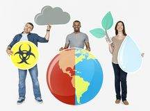 Diverse people holding global warming icons stock photo