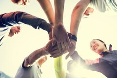Diverse people holding hands together