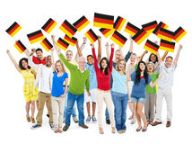 Diverse People Holding National Flag of Germany Stock Images