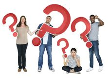 Diverse people holding question mark icons Stock Photos