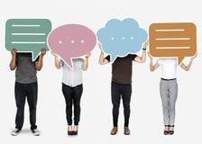 Diverse people holding speech bubble symbols royalty free stock photos