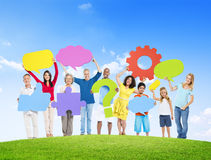 Diverse People Holding Symbols On a Hill Royalty Free Stock Photo