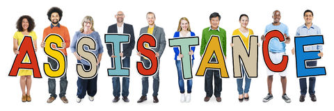 DIverse People Holding Text Assistance.  stock images