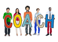 Diverse People Holding Text Coach Stock Image