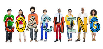 Diverse People Holding Text Coaching royalty free stock photography