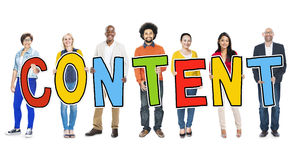 Diverse People Holding Text Content Stock Photography