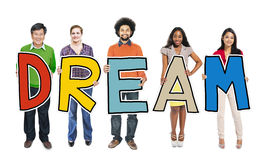 Diverse People Holding Text Dream Stock Image