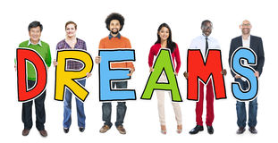 Diverse People Holding Text Dreams Royalty Free Stock Photos