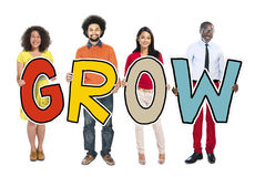 DIverse People Holding Text Grow.  Stock Images