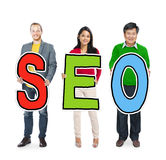 Diverse People Holding Text SEO Royalty Free Stock Photo