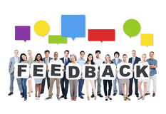 Diverse People Holding Word Feedback Stock Images