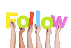 Diverse People Holding Word Follow. Multi-Ethnic Group of Diverse People Holding Letters To Form A Follow stock photo
