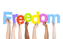 Diverse People Holding Word Freedom Stock Photo