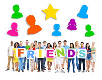 Diverse People Holding Word Friend Stock Photo